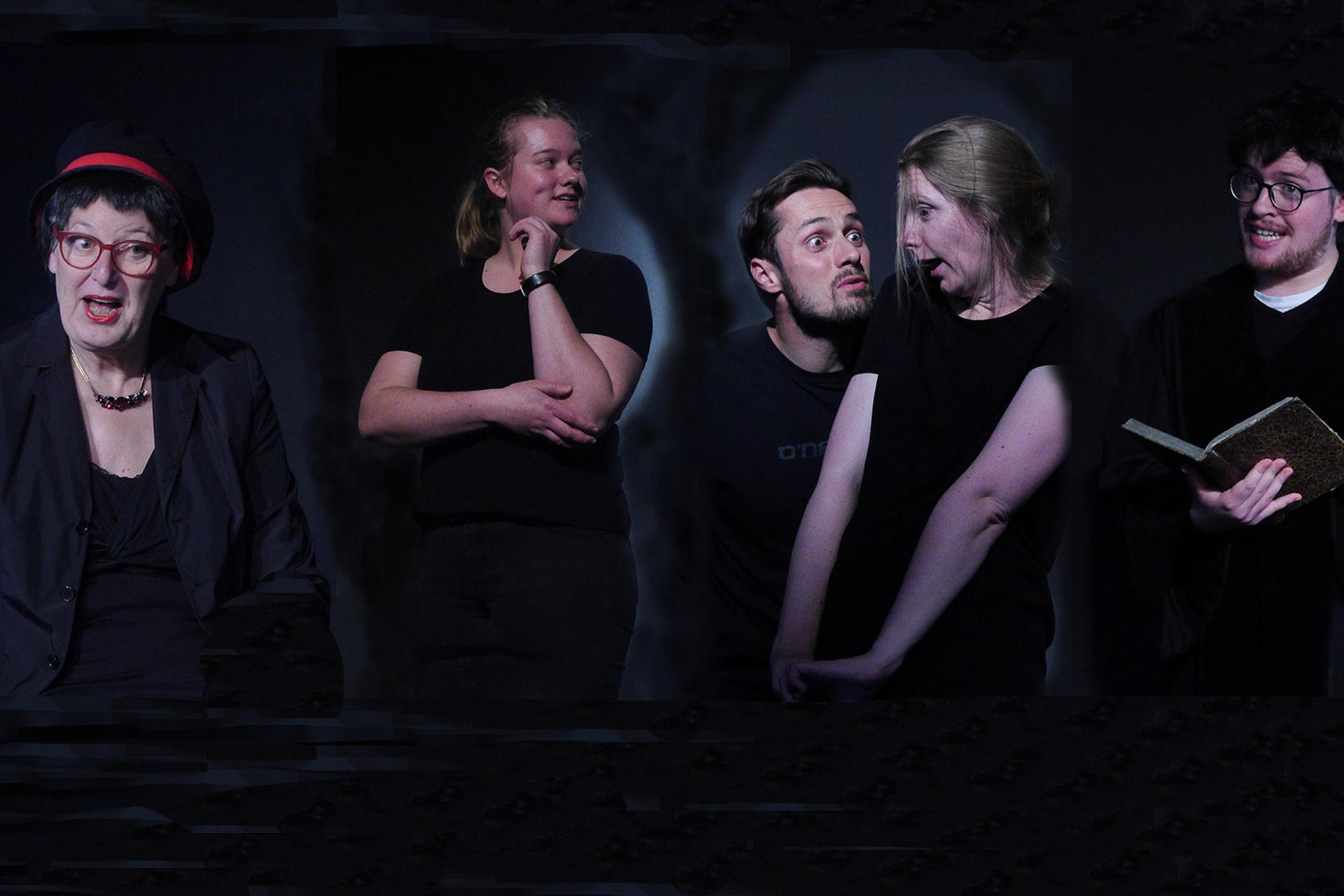 Männer und Frauen auf der schwarzen Bühne zeigen starke Mimik.